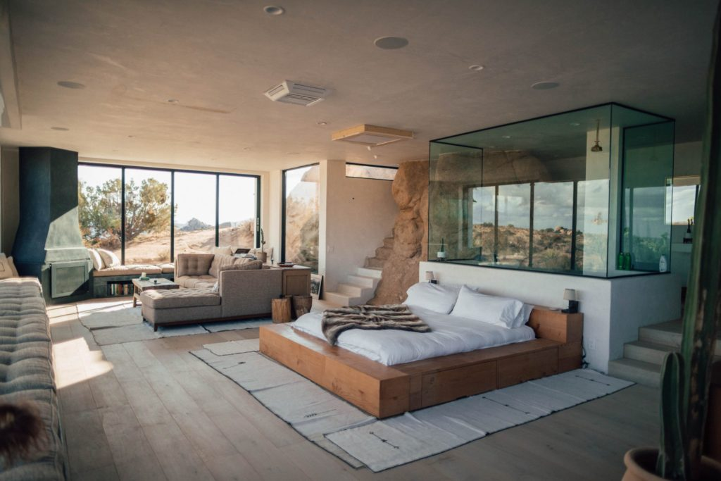 Modern bedroom decor example with glass and rock