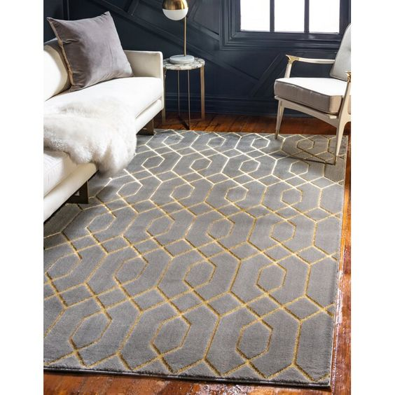 Grey and golden carpet in a modern living room