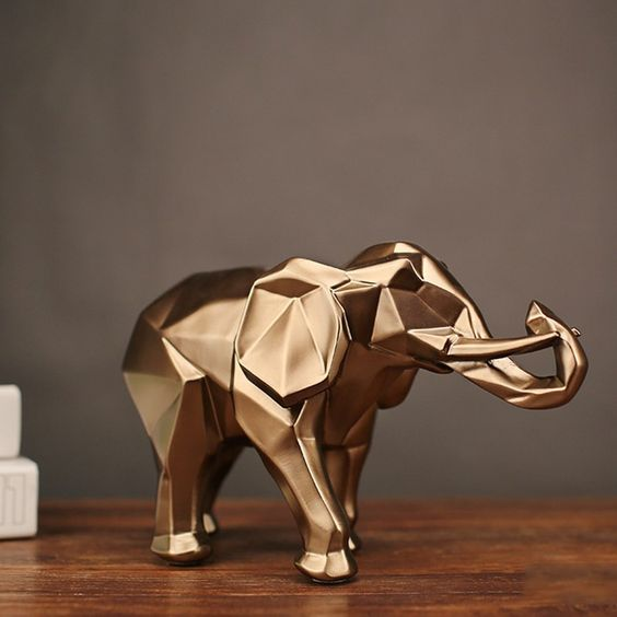 Golden elephant accessory for a modern home decor