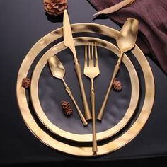 Golden cutlery with black plates