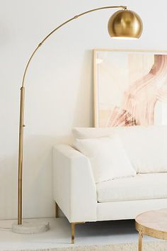 Golden floor lamp in a modern living room decor