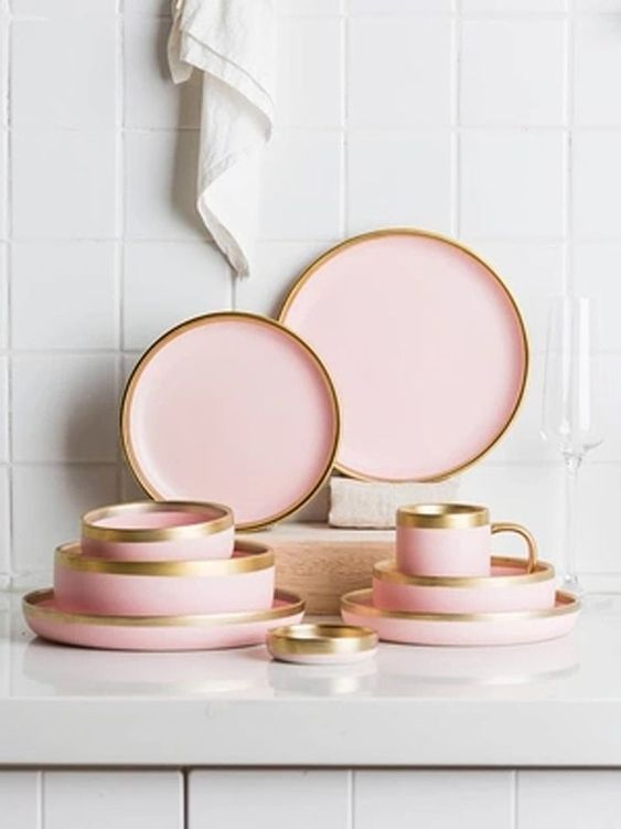 Golden lines on a set of pink plates