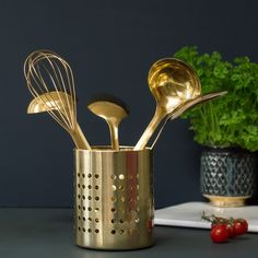 Golden utensils in a black and modern kitchen decor