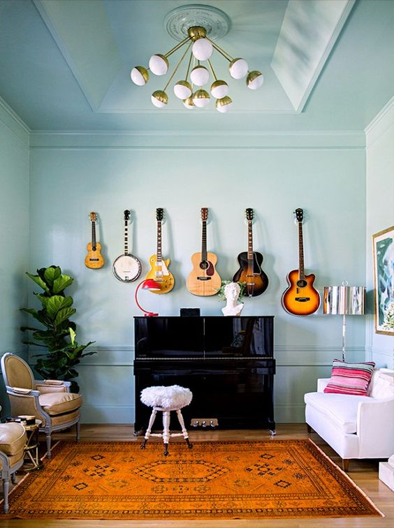 Guitars hanging on the wall to create a modern wall decor