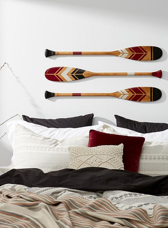 Decorated paddles in a modern wall decor
