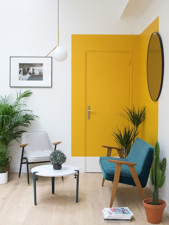 Modern living room corner, with an asymmetric yellow square painted on the wall