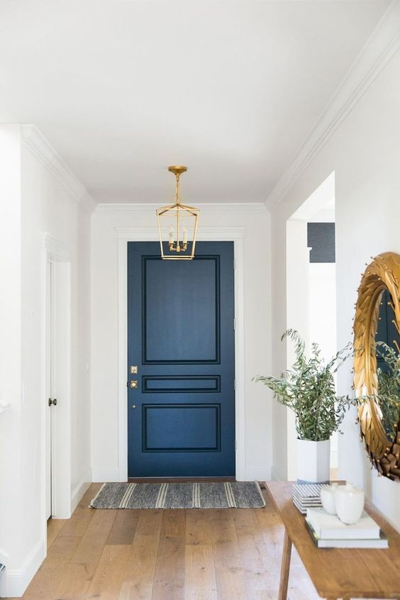 A blue door on white walls to create a modern style