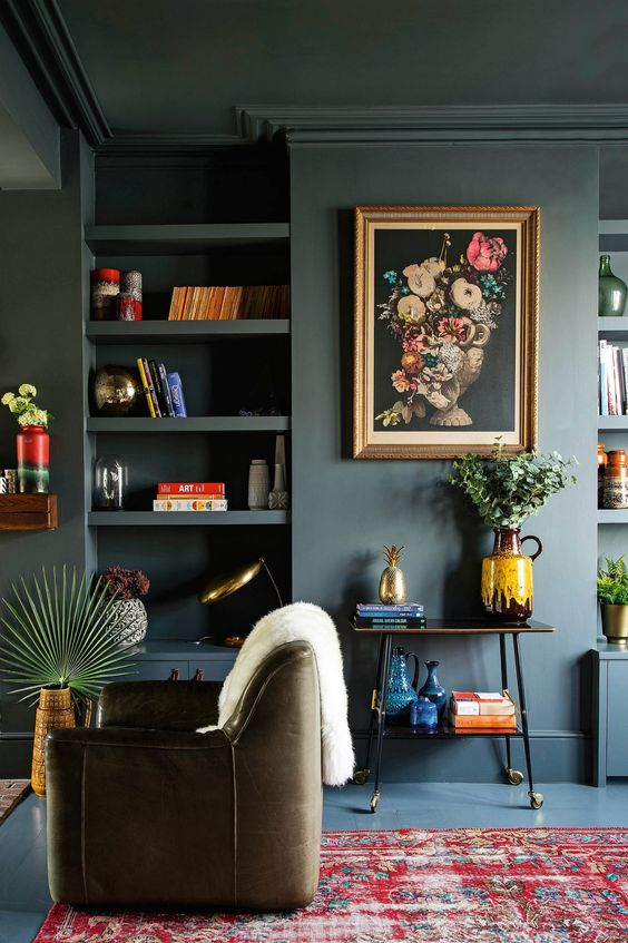 A modern living room with walls, floor and shelves painted with the same modern paint color
