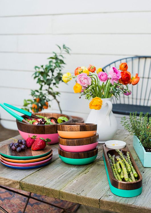 Wood and colorful tableware on a summer patio table